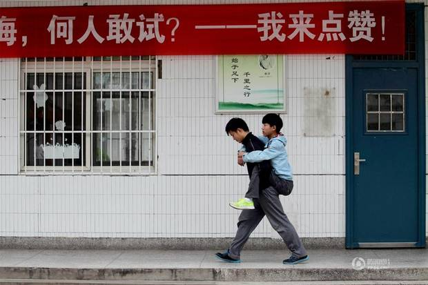 Student carries friend to school daily for 3 years